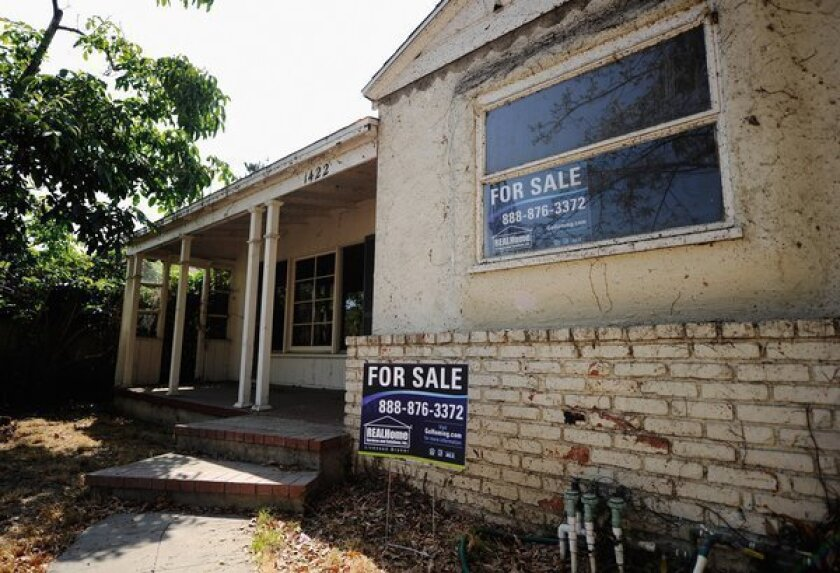 The number of homes in foreclosure and the inventory of repossessed homes on the market fell nationally in December. Above, a property in foreclosure in Glendale.