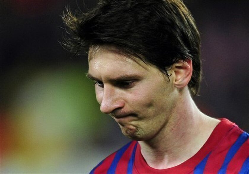 FC Barcelona's Lionel Messi, from Argentina, reacts at the end of the match against Chelsea in a semifinal second leg Champions League soccer match at the Camp Nou stadium in Barcelona, Spain, Tuesday, April 24, 2012.  Chelsea drew 2-2 with Barcelona to win the match 3-2 on aggregate. (AP Photo/Man
