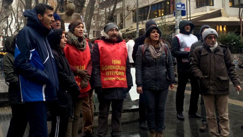 Nuriye Gulmen (third from left, orange vest) and Semih Ozakca (fourth from left, orange vest) chant asking for their jobs back as part of their daily protest in Ankara, Turkey.