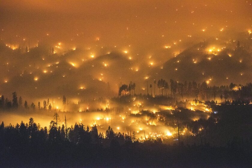 A long exposure image shows the El Portal fire burning late Sunday near Yosemite National Park.