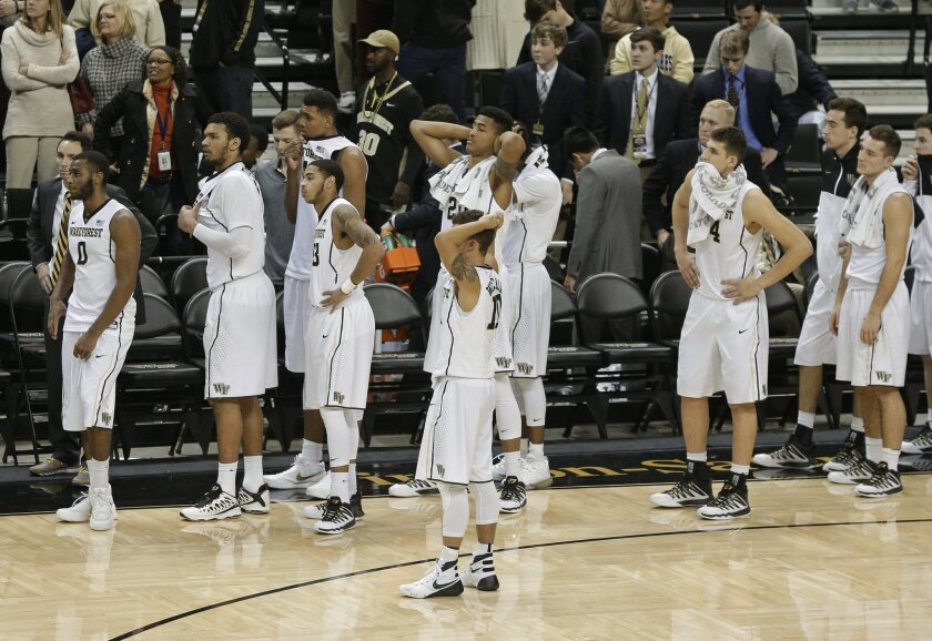 Wake Forest players react after Virginia's last-second game-winning shot in the second half of an NCAA college basketball game in Winston-Salem, N.C., Tuesday, Jan. 26, 2016. Virginia won 72-71. (AP Photo/Chuck Burton)