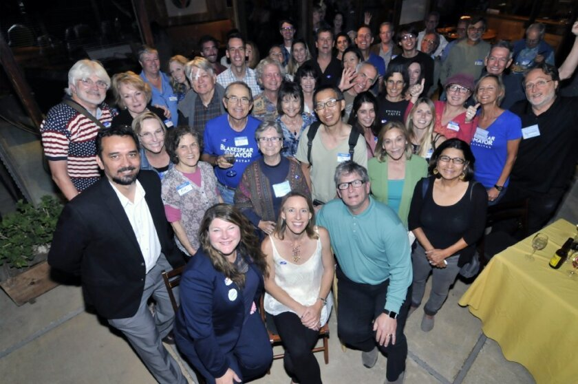 Surrounded by supporters at a Nov. 8 victory party are, from left to right seated, newly elected Encinitas City Council member Tasha Boerner Horvath, elected Mayor Catherine Blakespear and re-elected City Council member Tony Kranz.