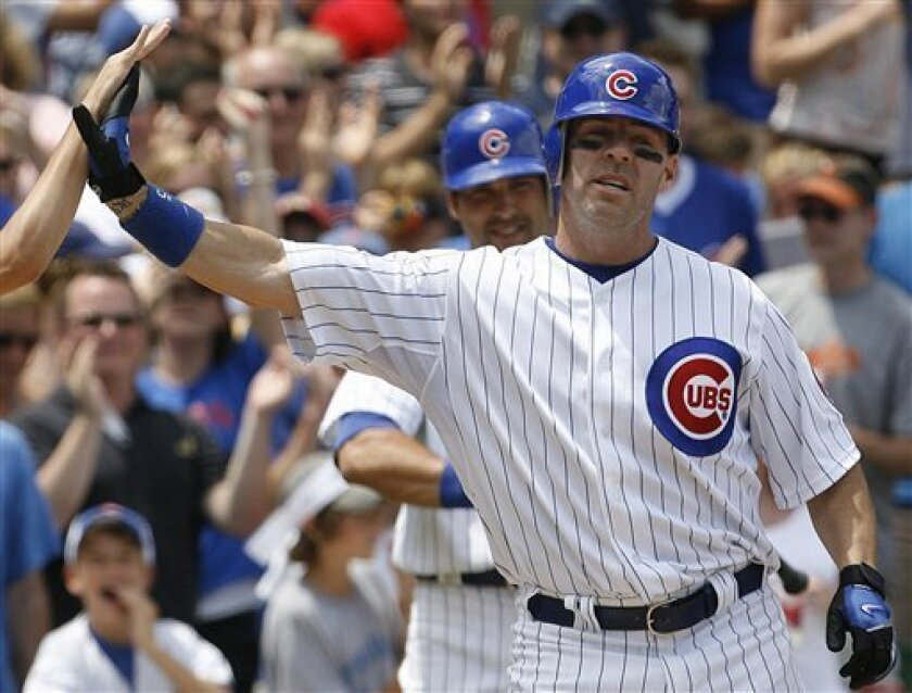 Chicago Cubs' Jim Edmonds celebrates with his teammate after hitting his second solo home run against Chicago White Sox during the fourth inning of an interleague baseball game Saturday, June 21, 2008 in Chicago. (AP Photo/Nam Y. Huh)