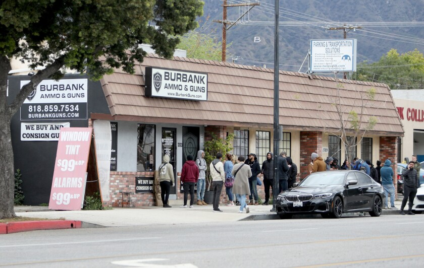Customers line up outside Burbank Ammo & Guns on Magnolia Ave. in Burbank on March 17, 2020.