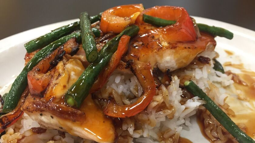"""Glazed salmon teriyaki with bok choy and jasmine rice, one of the new menu items developed by chef Robert Irvine at The Incredible Cafe in Rancho Bernardo, which recently underwent a $10,000 revamp for the Food Network TV series """"Restaurant: Impossible."""""""