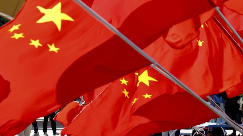 Chinese national flags fly in Beijing.
