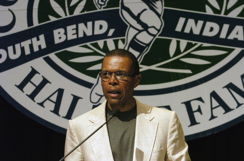 Gale Sayers speaks at a College Football Hall of Fame event June 2, 2004.