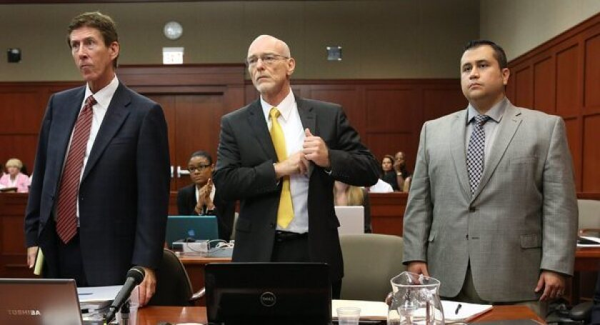 George Zimmerman, right, with attorneys Mark O'Mara, left, and Don West as the jury enters the courtroom in Sanford, Fla.