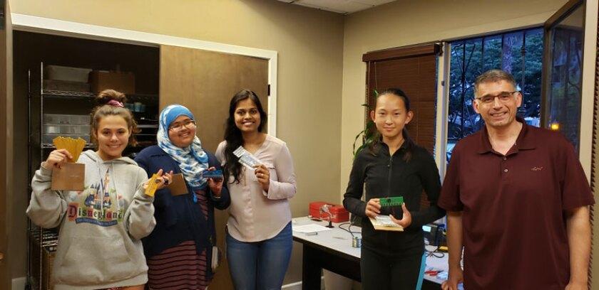 Dalia Sebat, Fahima Sahib, Darpana Pendyala (teacher), Grace Wang, Babak Aryan (teacher) showing their electronic pianos.