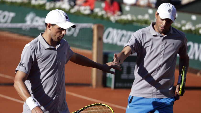 Bob, left, and Mike Bryan celebrate a point during their French Open doubles final match at Roland Garros in Paris on June 6.