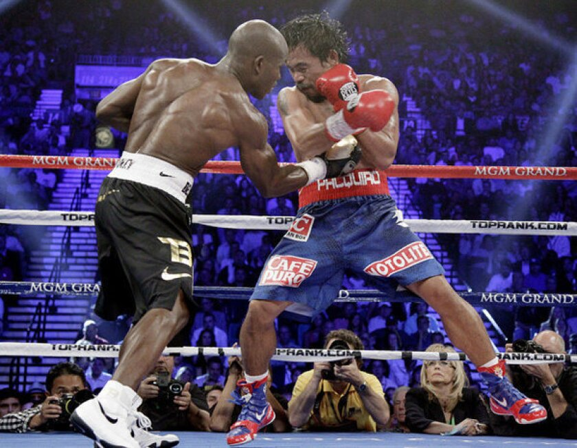Timothy Bradley lands a right to the body of Manny Pacquiao.