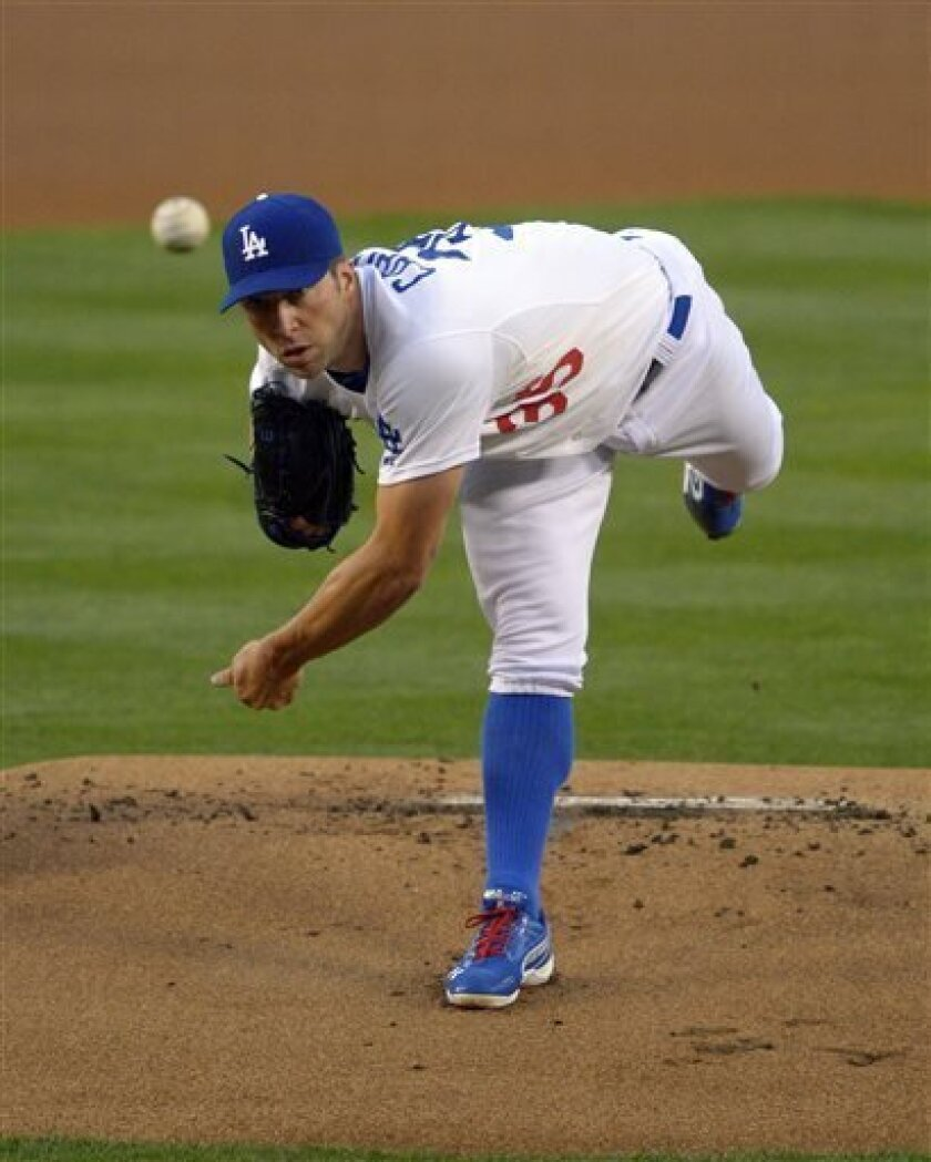 Los Angeles Dodgers starting pitcher Chris Capuano throws to the plate during the first inning of their baseball game against the San Diego Padres, Tuesday, April 16, 2013, in Los Angeles. (AP Photo/Mark J. Terrill)