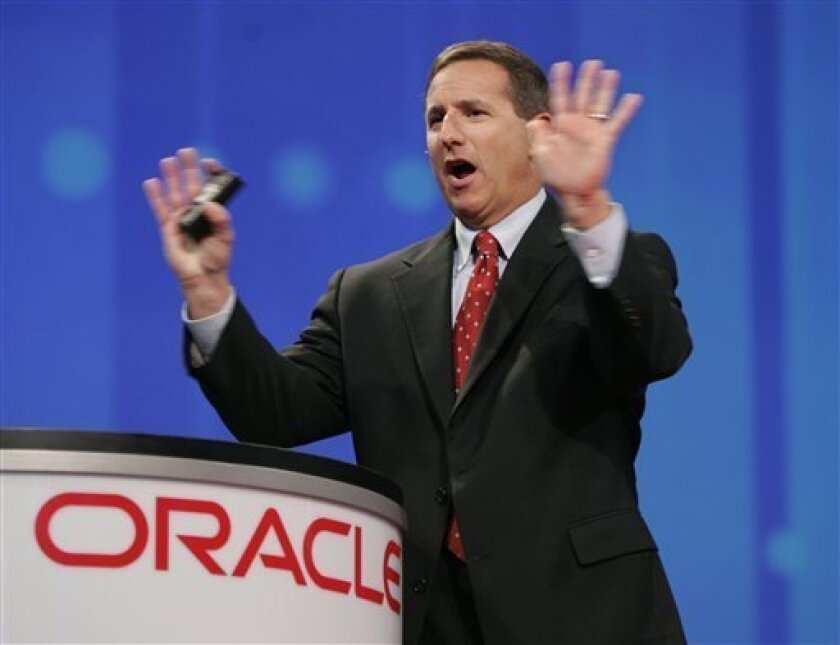 FILE - In this Oct. 24, 2006 file photo shows then, Hewlett Packard CEO Mark Hurd gestures during a keynote address at the Oracle Open World conference in San Francisco. Oracle Corp. has hired former Hewlett-Packard Co. CEO Mark Hurd to help lead the database software maker in a pivotal moment in O