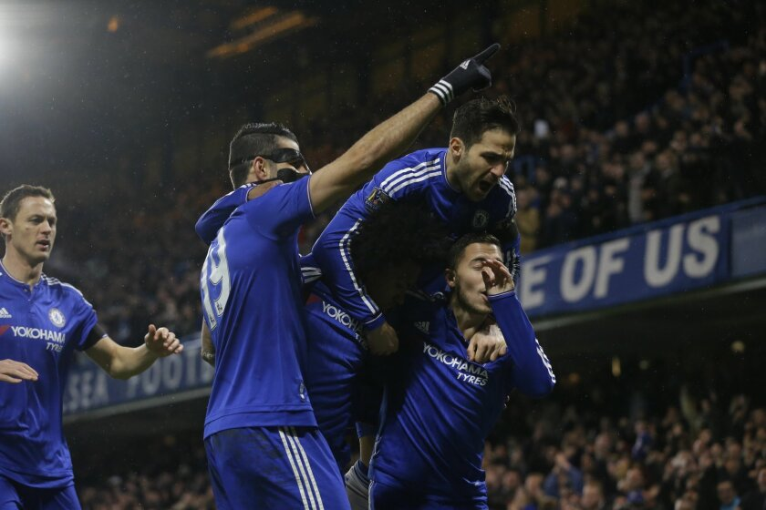 Chelsea's Diego Costa, second left, celebrates scoring his side's first goal with Cesc Fabregas, top, Eden Hazard, right, and Willian, center, during the English Premier League soccer match between Chelsea and Newcastle United at Stamford Bridge stadium in London, Saturday, Feb. 13, 2016.  (AP Phot