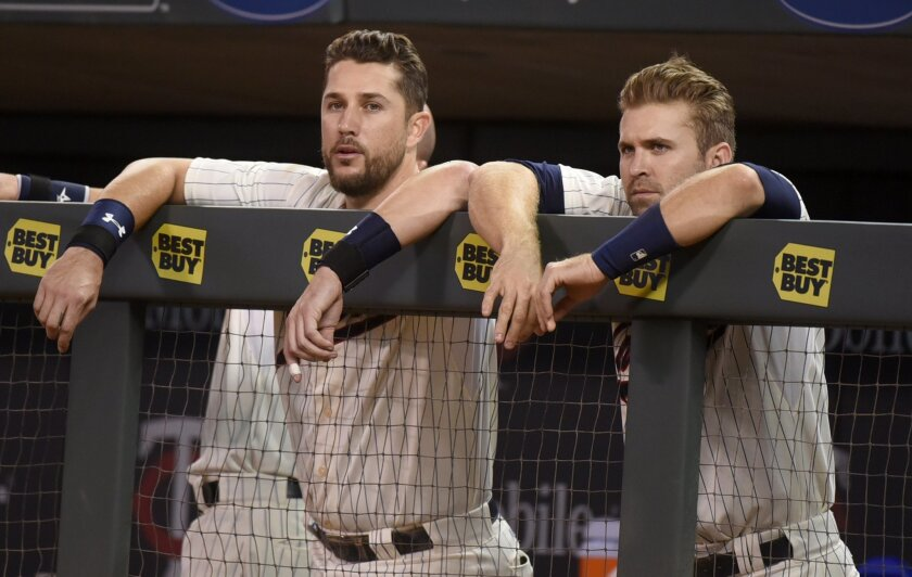 Minnesota Twins third baseman Trevor Plouffe, left and second baseman Brian Dozier watch as their ninth inning rally dies during the Twins' 5-2 loss to the Los Angeles Angels in Game 2 of a split double header baseball game, Saturday Sept. 19, 2015, in Minneapolis. (AP Photo/Richard Marshall)
