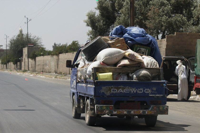 Yemenis drives their truck with their belongings in Sanaa, Yemen, Thursday, April 2, 2015. People in the capital have fled from their houses to their hometown villages and towns in fear of crashes between the Saudi-led coalition and Shiite rebels. (AP Photo/Hani Mohammed)