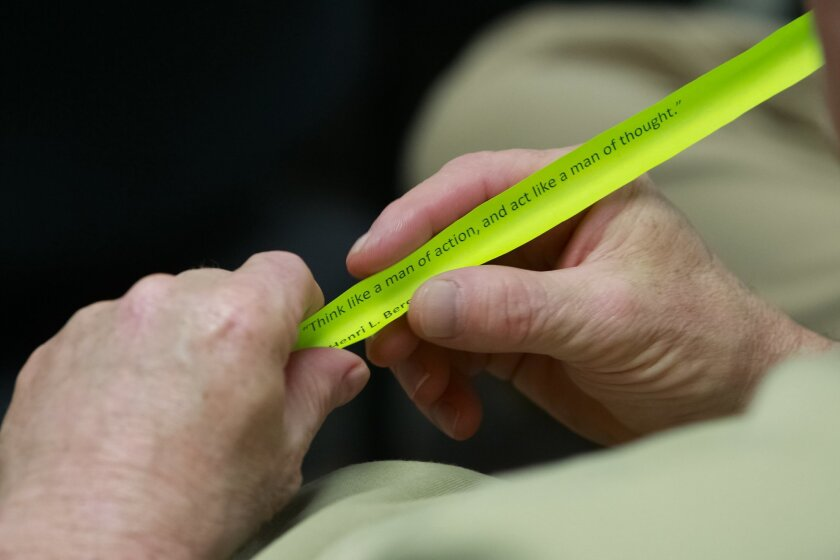 Inmates at the East Mesa Reentry Facility Job Center are given stripes of paper called the daily vitamin with printed quotes of inspiration. The program helps inmates prepare for job interviews before their release from jail.