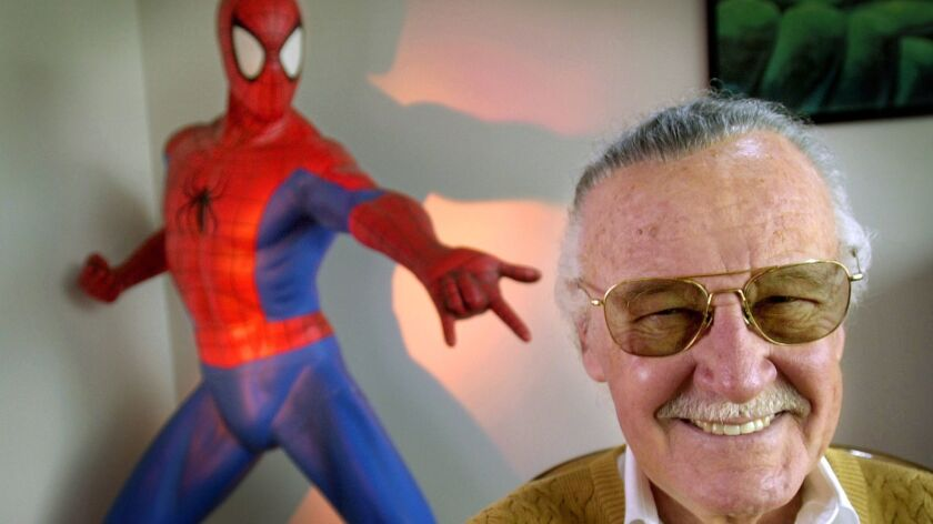 "Stan Lee, in 2012, creator of comic-book franchises such as ""Spider-Man,"" ""The Incredible Hulk"" and ""X-Men,"" smiles during a photo session at his office in Santa Monica. Comic book genius Lee, the architect of the contemporary comic book, has died at age 95."