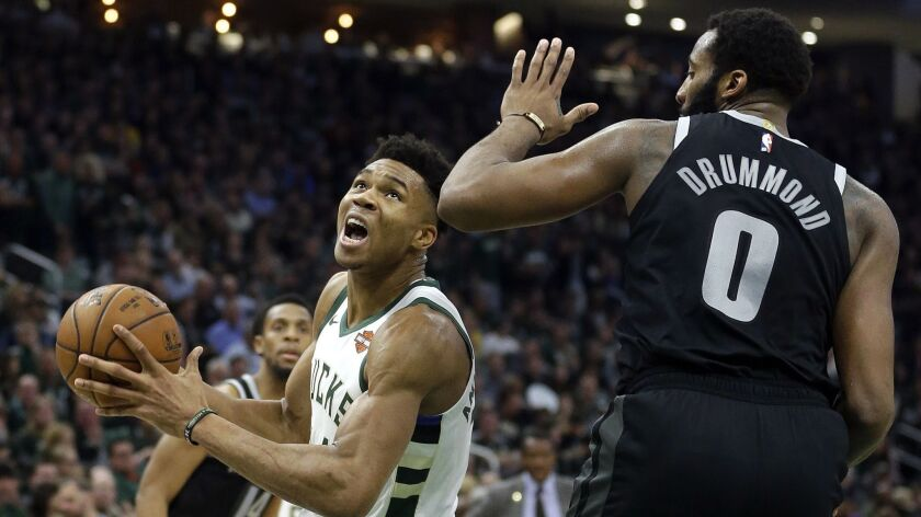 Milwaukee Bucks' Giannis Antetokounmpo drives to the basket against Detroit Pistons' Andre Drummond