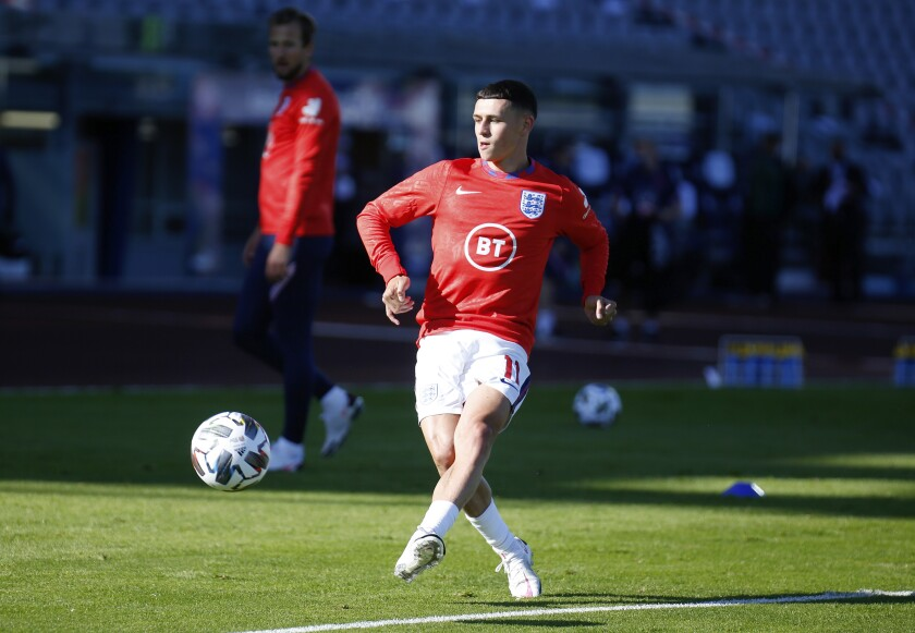 England's Phil Foden warms-up before the UEFA Nations League soccer match between Iceland and England in Reykjavik, Iceland, Saturday, Sept. 5, 2020. (AP Photo/Brynjar Gunnarson)