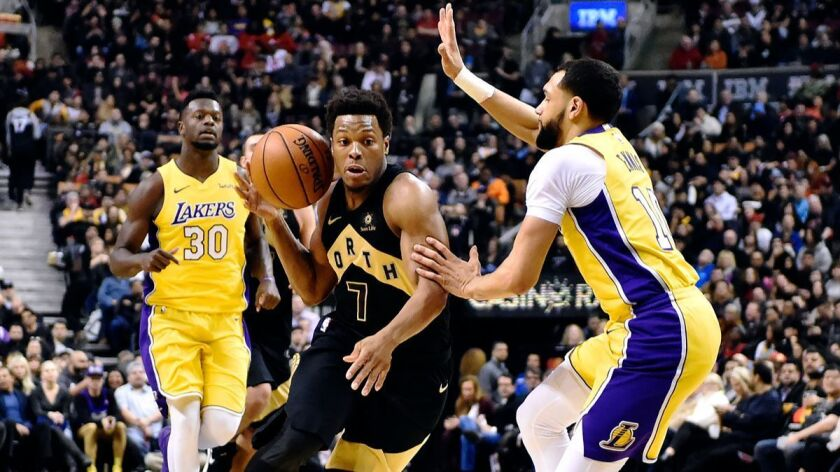 Toronto Raptors guard Kyle Lowry (7) drives against Los Angeles Lakers guard Tyler Ennis (10) during