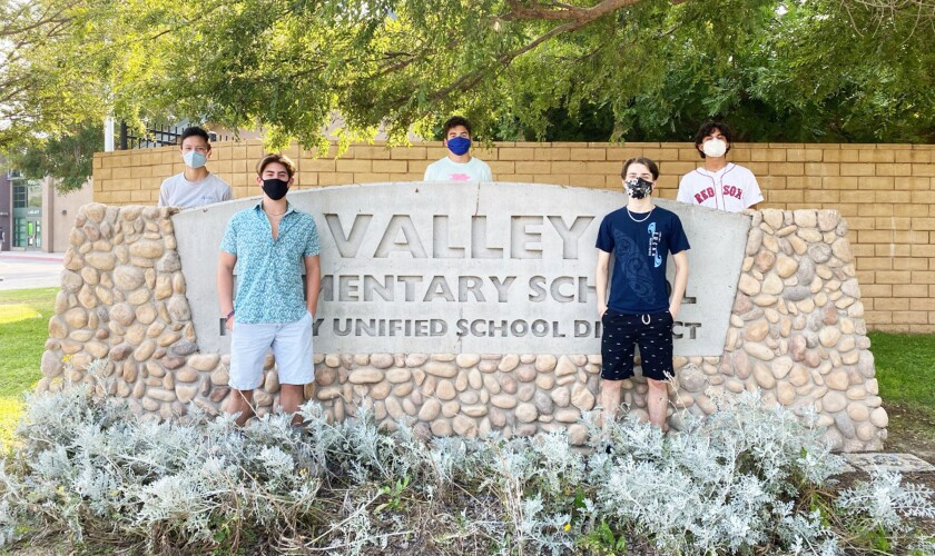 Brandon Shen, Sean Danahy, Max Anger, Drew Floyd and Juan Montano in front of their former elementary school.