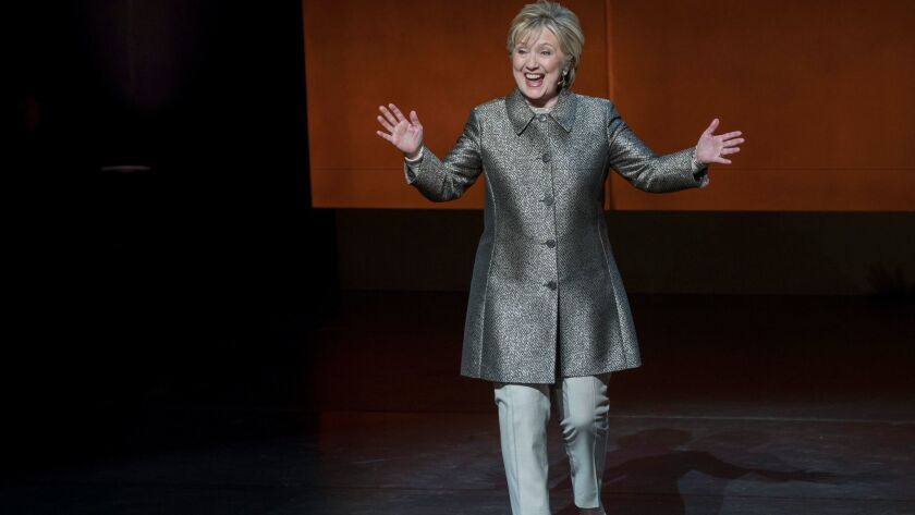 Hillary Clinton reacts to applause as she arrives on stage at Lincoln Center.