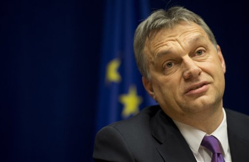 Hungary's Prime Minister Viktor Orban listens to questions during a media conference at an EU summit in Brussels on Thursday, March 14, 2013. European Union heads of state and government meet for a two-day summit, beginning Thursday, to discuss the current financial crisis. (AP Photo/Geert Vanden W