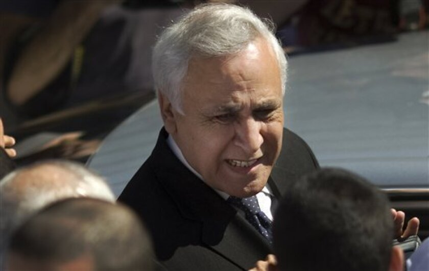 Former Israeli President Moshe Katsav enters his car after leaving the court house in Tel Aviv, Israel, Tuesday, March 22, 2011. An Israeli court ordered former Israeli President Moshe Katsav to prison for seven years Tuesday following his rape conviction, rejecting his attorneys' request for leniency and making him the highest-ranking Israel official ever sent to jail. (AP Photo/Ariel Schalit)