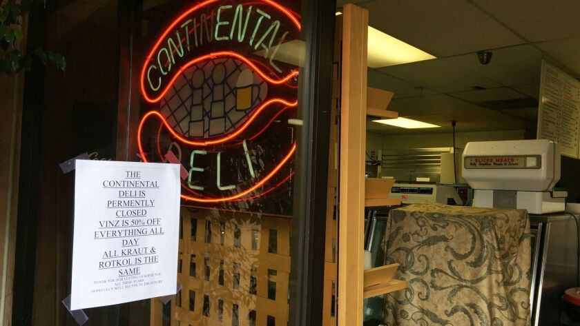 A sign on the door ar Continental Delicatessen in Escondido, which closed Saturday after 52 years in business, thanks customers for their support. Facing eviction, owners Vinnie and Michelle Griffin closed the deli on Saturday and nearby Vinz Wine Bar's last day was on Monday.