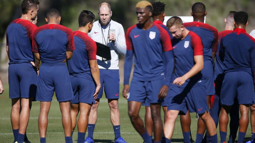 Gregg Berhalter, head coach of the United States men's national soccer team, talks to players during a practice in Chula Vista, Calif., on Jan. 7.