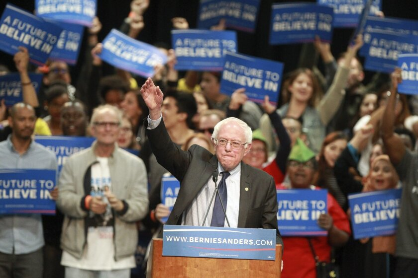 Democratic presidential candidate Bernie Sanders waves to the crowd as he prepares to speak to thousands of supporters at the downtown convention center Tuesday, March 22.