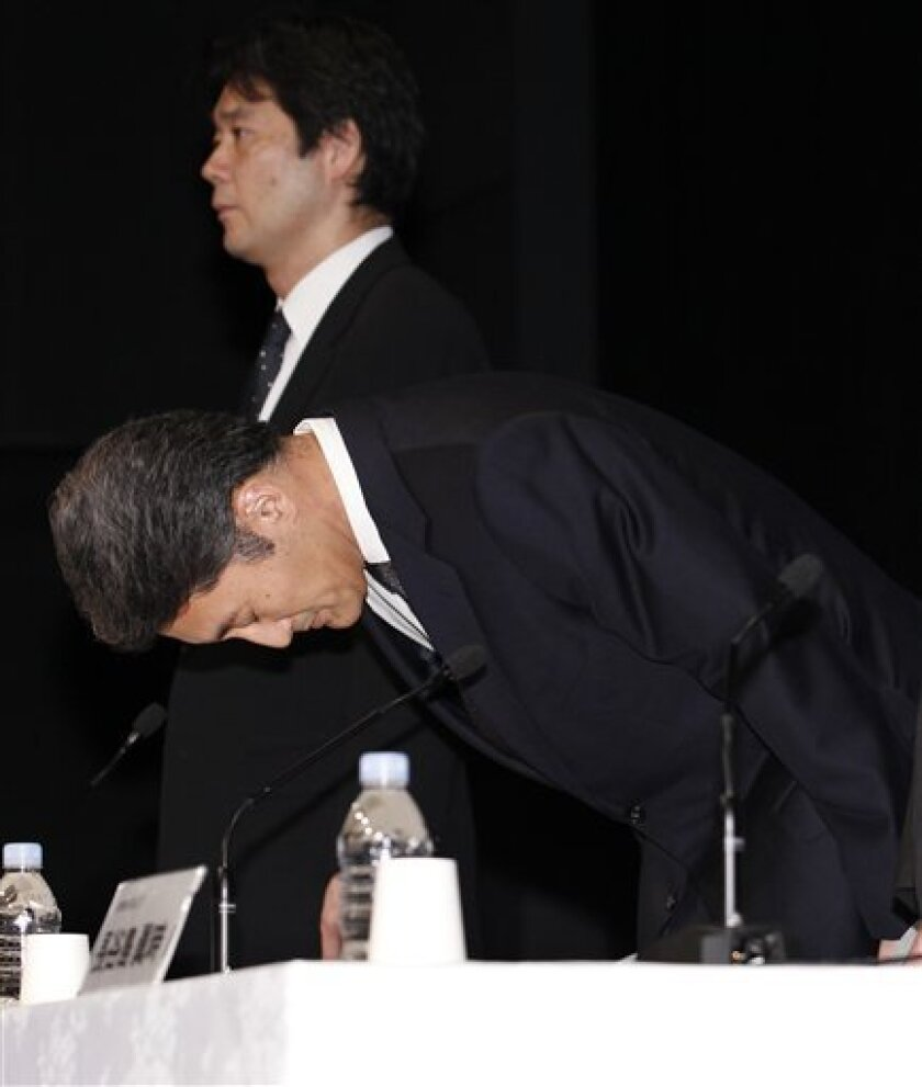 Sony Computer Entertainment President and CEO Kazuo Hirai bows in apology for the data security breach before the start of a press conference at the Sony Corp. headquarters in Tokyo.