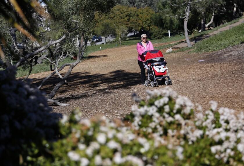 Linda Gonzalez walks on the Veterans Parkway, a 3.5-mile-long green belt that runs from Hermosa Beach to Manhattan Beach.