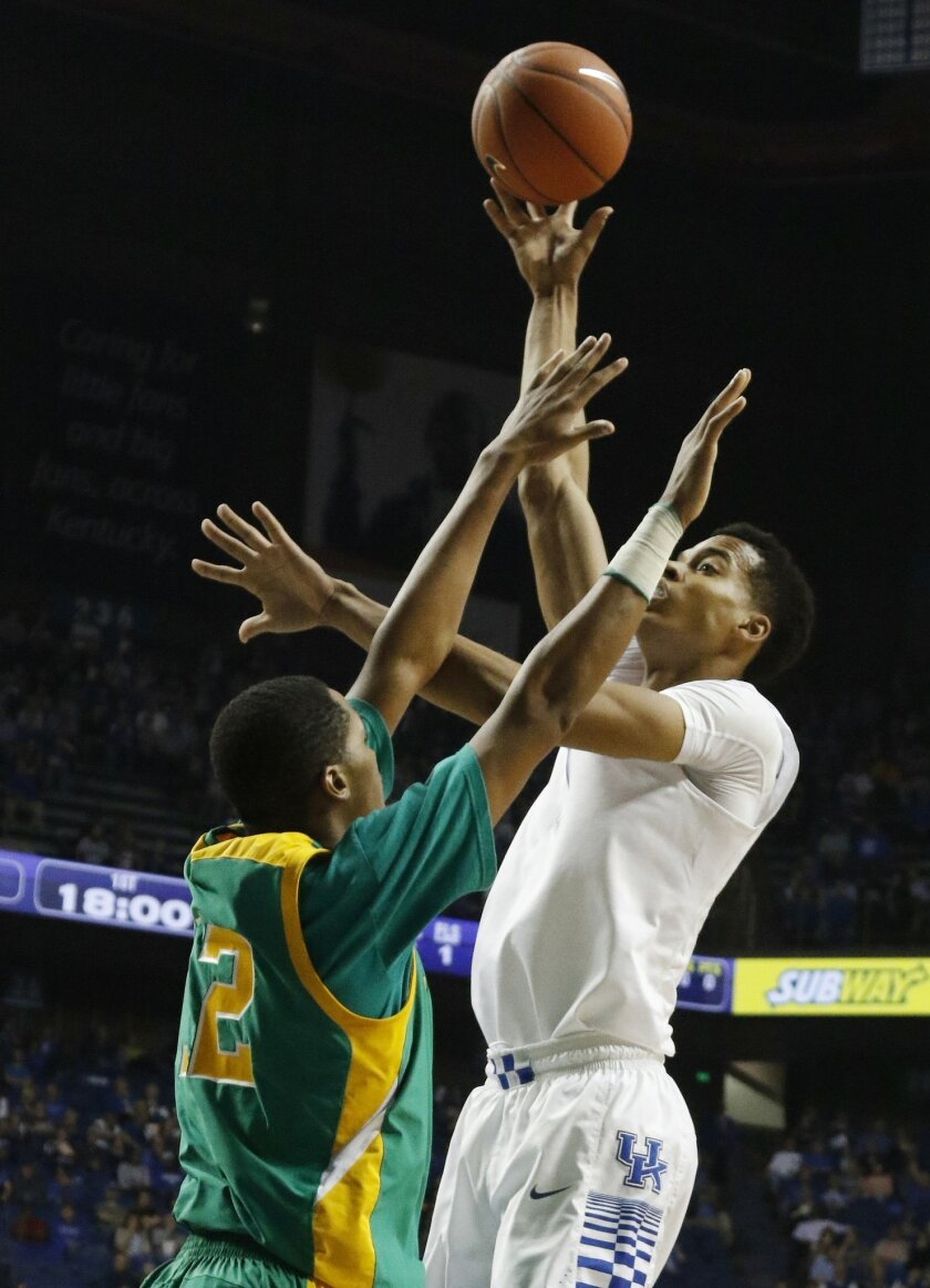 Kentucky's Skal Labissiere, right, shoots under pressure from Kentucky State's Julius Barton during an NCAA college basketball exhibition game Friday, Nov. 6, 2015, in Lexington, Ky. (AP Photo/James Crisp)