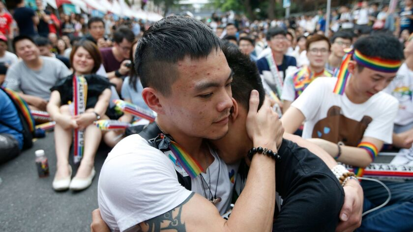 epa05985566 Supporters of the LGBT (Lesbian, Gay, Bisexual and Transgender) rights react as they gat