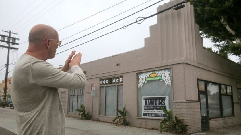 Christopher Puffer, partner in a new restaurant in downtown Encinitas called Herb and Sea, shows the historic building on D Street that will house the new eatery.