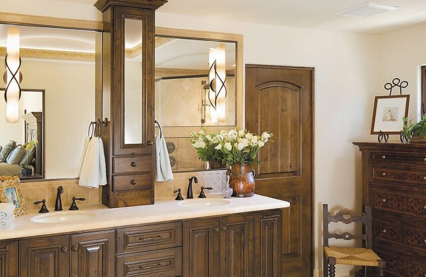 A combination of mirrors gives this bathroom an Old World feeling.