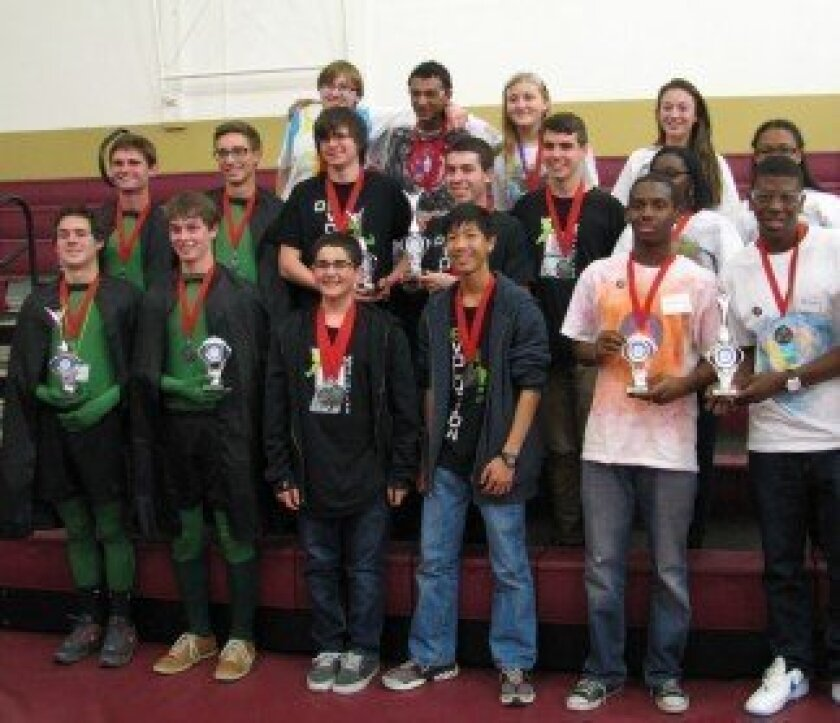 Team De-Evolution (center) with their Winning Alliance partners. To the left of De-Evolution is Team Syntax Error from Santa Barbara and to the right is Team Millionaire Mind Kids from Victorville.