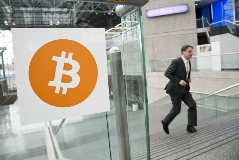 A man arrives for the Inside Bitcoins conference and trade show in New York in April.
