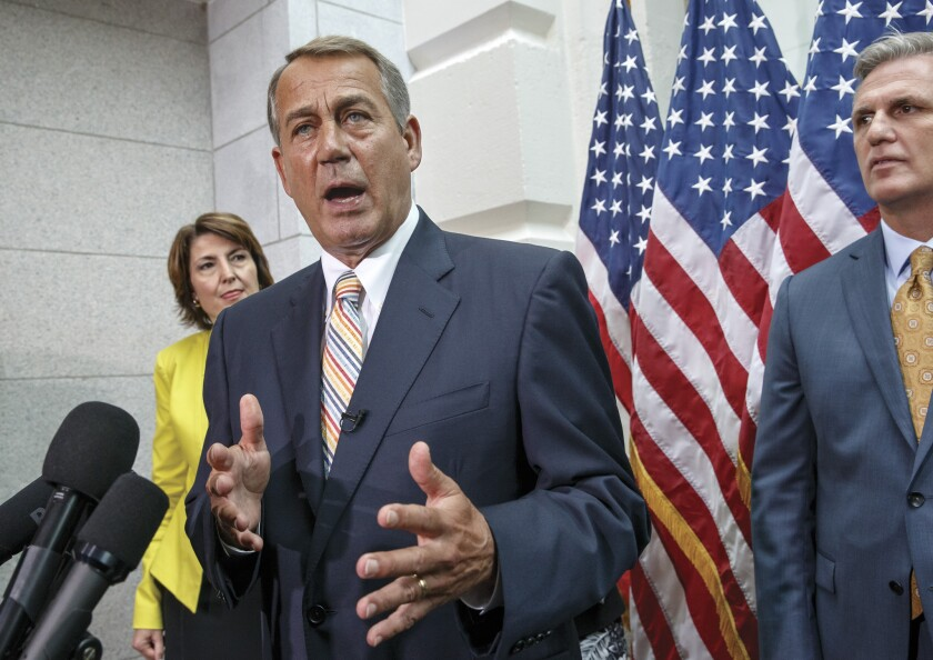 House Speaker John A. Boehner, flanked by Rep. Cathy McMorris Rodgers and Majority Leader Kevin McCarthy, speaks to reporters on Capitol Hill on Tuesday.