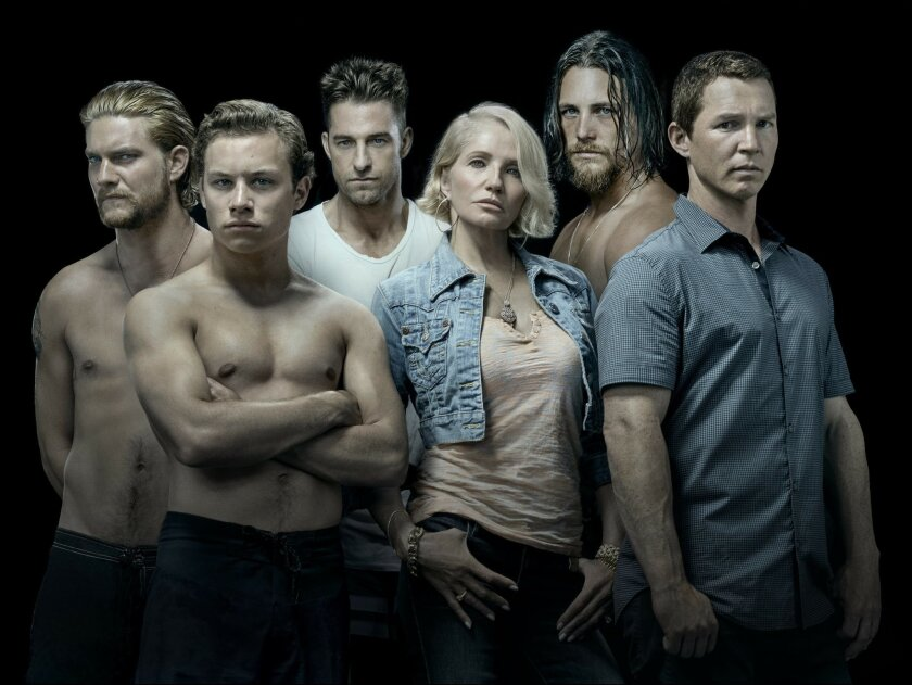 """This image released by TNT shows the cast of the new series """"Animal Kingdom,"""" starring Ellen Barkin, from row center, as the matriarch of a crime family. Kevin Reilly has begun the process of transforming the Turner Networks of TBS and TNT from a home for television comfort food into what he hopes"""