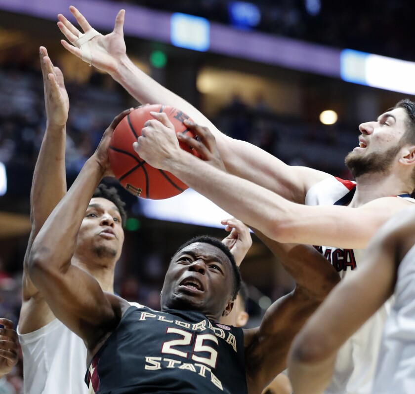 ANAHEIM, CALIF. - MAR. 28, 2019. Florida State forward Mfiondo Kabrngele gets hemmed in by the Gon