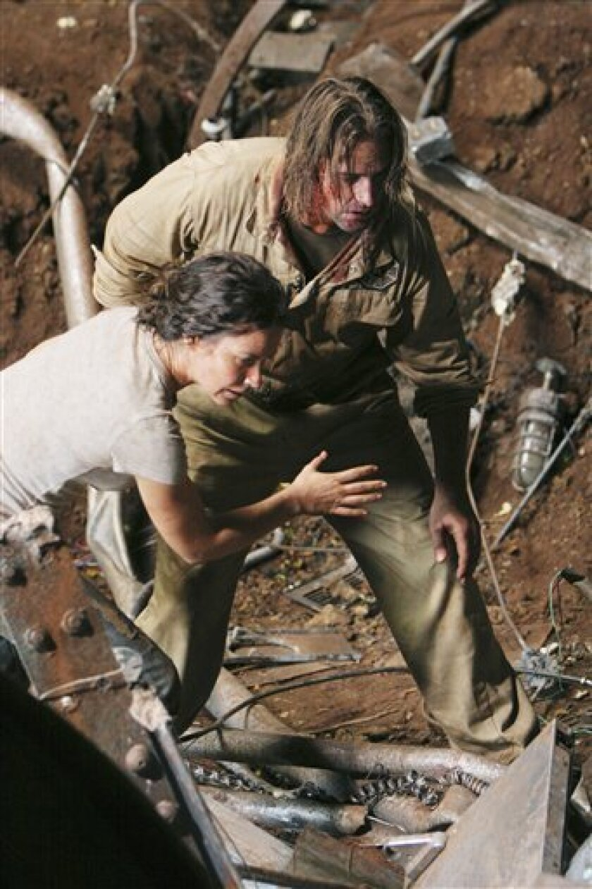 """This photo released by ABC shows Evangeline Lilly,left, and Josh Holloway a scene from """"Lost"""" which returns for its final season. The end is coming May 23, according to """"Lost"""" co-creators Carlton Cuse and Damon Lindelof, who made it official Tuesday Feb. 2, 2010, during guest appearances on """"Jimmy Kimmel Live!"""" (AP Photo/ABC,Mario Perez)"""