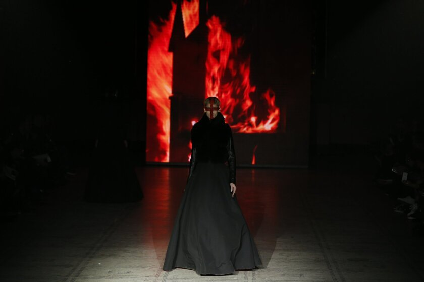 A model wears an outfit by designer Gareth Pugh during his Autumn/Winter 2015 show at London Fashion Week, in London, Saturday, Feb. 21,2015. (AP Photo/Alastair Grant)