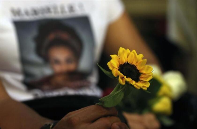 Friends, relatives and activists attend a mass on the first anniversary of the murder of late Brazilian councilor Marielle Franco, in Rio de Janeiro, Brazil, on March 14, 2019. EFE/ Antonio Lacerda