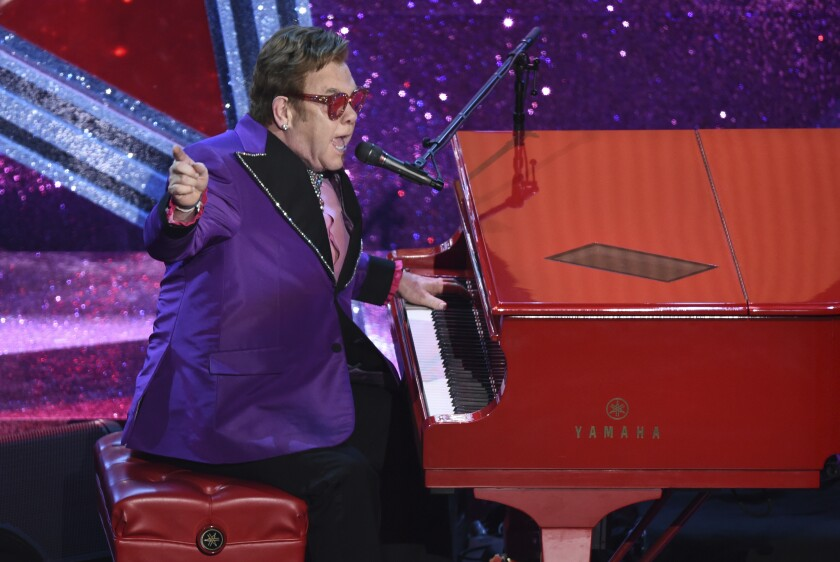 "FILE - In this Feb. 9, 2020, file photo, Elton John performs ""(I'm Gonna) Love Me Again,"" nominated for the award for best original song, from ""Rocketman"" at the Oscars in Los Angeles. John is opening up his vault and releasing an expansive collection of rarely heard and unreleased tracks. John announced Thursday, Sept. 17, 2020, that the eight-CD collection, ""Elton: Jewel Box,"" will be released Nov. 13. The collection includes ""Sing Me No Sad Songs,"" an unreleased studio demo from 1969. (AP Photo/Chris Pizzello, File)"