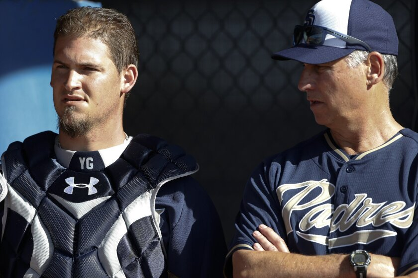 Padres manager Bud Black (right) talks with catcher Yasmani Grandal as the third day of spring training began for the Padres pitchers and catchers.