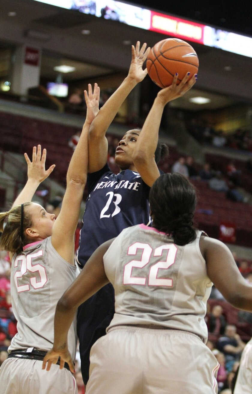Penn State's Ariel Edwards (23) shoots over Ohio State's Amy Scullion (25) and Darryce Moore (22) during the first half of an NCAA college basketball game on Sunday, Feb. 9, 2014, in Columbus, Ohio. (AP Photo/Mike Munden)