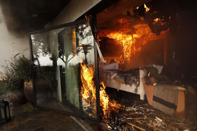 BEL AIR - DECEMBER 6, 2017 -- The bedroom of a home is engulfed in flames from the Skirball fire alo